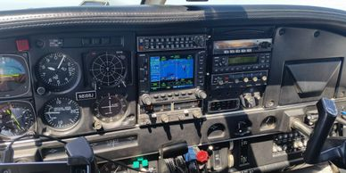 Piper airplane cockpit in flight
