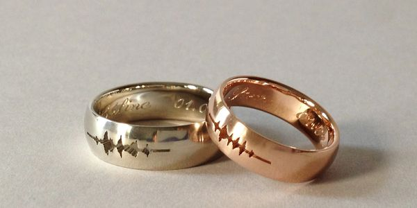 18K palladium white gold and 18K pink gold custom sound waveform wedding ring
