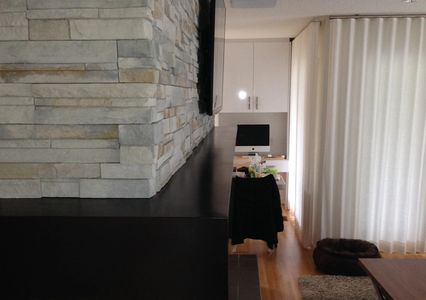 Ledge stone installation , natural stone, fireplace wall