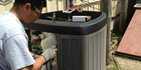 Hardon's employee installing a Dave Lennox signature air conditioner for home comfort