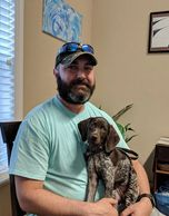 Remington is a German shorthaired pointer bought by Chris' wife for him to train as his service dog.