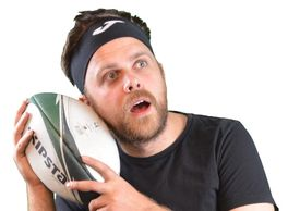 Dan listening to the rugby ball