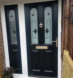 Black Solid Core composite front door with matching composite side panel fitted in Arnold.