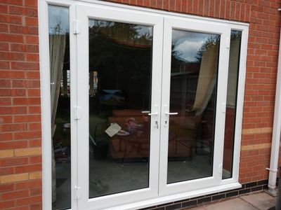 UPVC French Doors with two side panels installed in Grimsby by our trained Mansfield fitters.