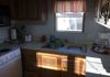 Kitchen - coffee maker, microwave, refrigerator, range, dishes, pots and pans