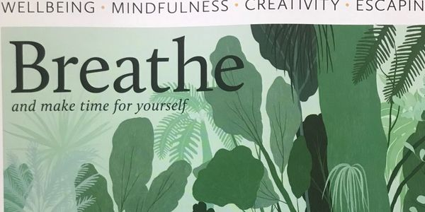 Front cover of Breathe magazine showing green leaves and writing