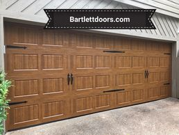 Wood grain carriage door installed by Bartlett Garage Doors in Memphis, TN bartlettdoors.com