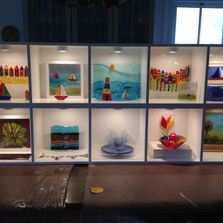 Display of fused glass.  Variety of fused glass and multimedia Art.  Can be made to order.
