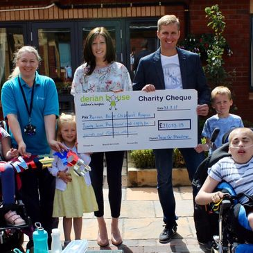 Nick & Karen Isherwood presenting the cheque from Supercar Showtime to Derian House Children's Hospice