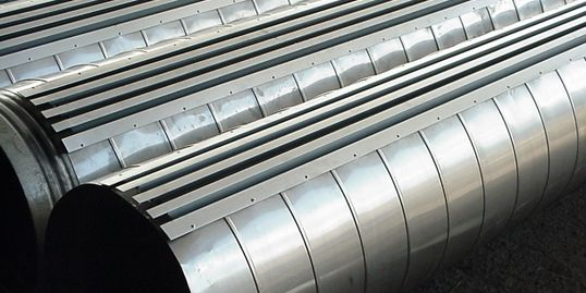 Stainless steel spiral duct with surface mountd linear diffusers.