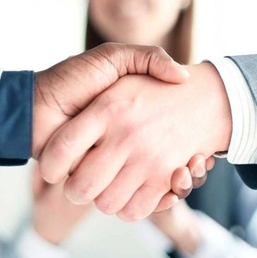 a handshake symbolizing the win/win philosophy of Chapter & Verse Creative Content