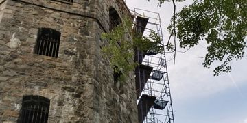 Scaffolding was erected to assess the current conditions of the tower and remove the debris