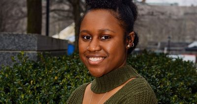 Social work graduate student Ashlé Hall, entrepreneur with a new line of hair care products.