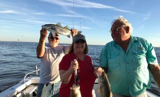 Jigging for stripers - Annapolis fishing charters on board the Down Time