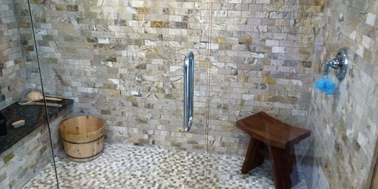 Pasadena Yacht & country club shower redesign, features Travertine bath tiles with soapstone seat.