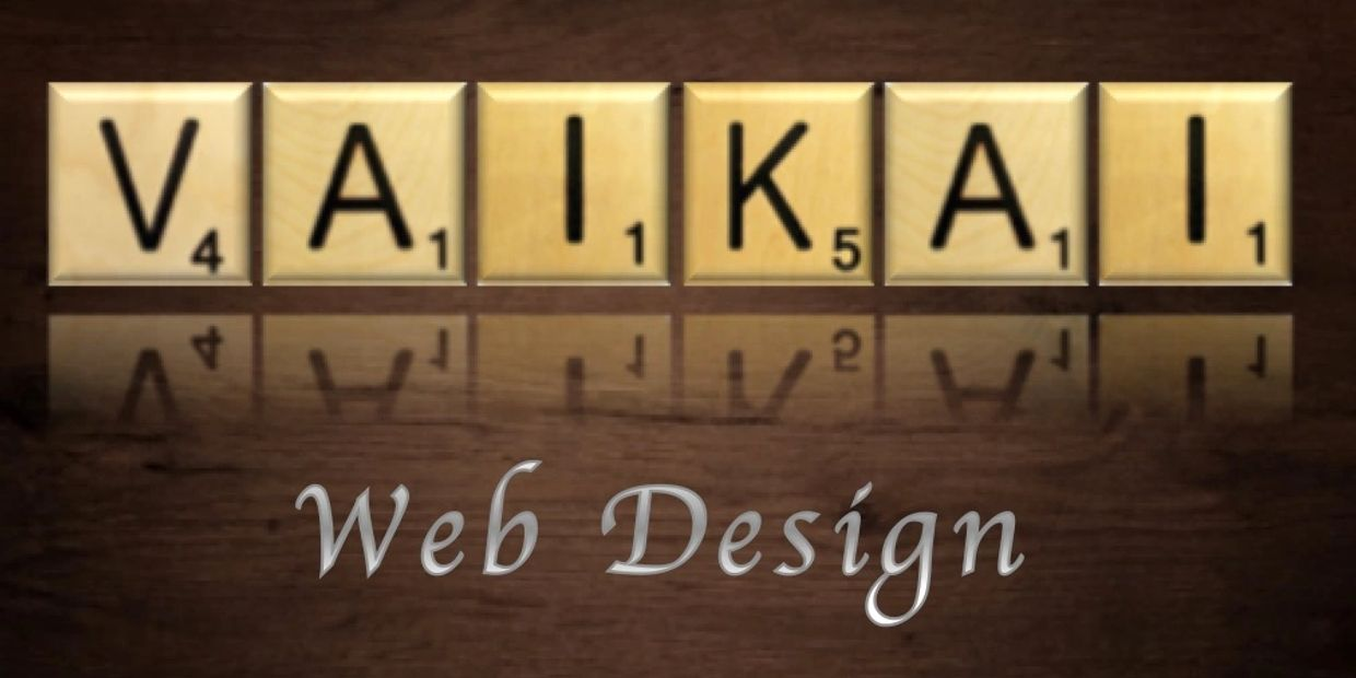 Vaikai web design logo. Wooden scrabble tiles showing a reflection on wooden table.
