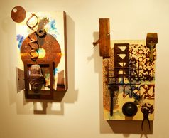 Mixed-media wall sculptures combining rust prints, paint and found objects.