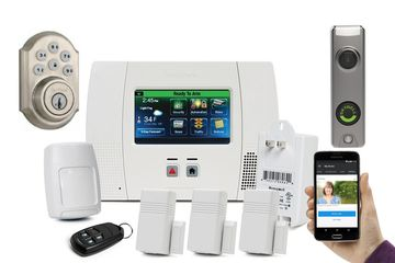 Honeywell Lynx L5210 Home security systes. Including 3 door sensors, 1 motion, 1 remote control.