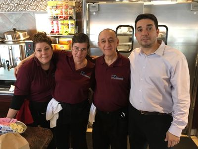 Stefan Stefanopoulous, co-owner of the Thornwood Coach Diner with three of his trusted employees.