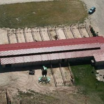 Aerial view of barn with paddocks
