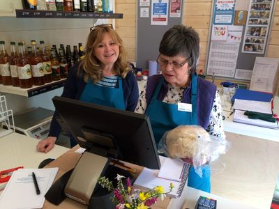 volunteers behind the counter in slapton village community shop