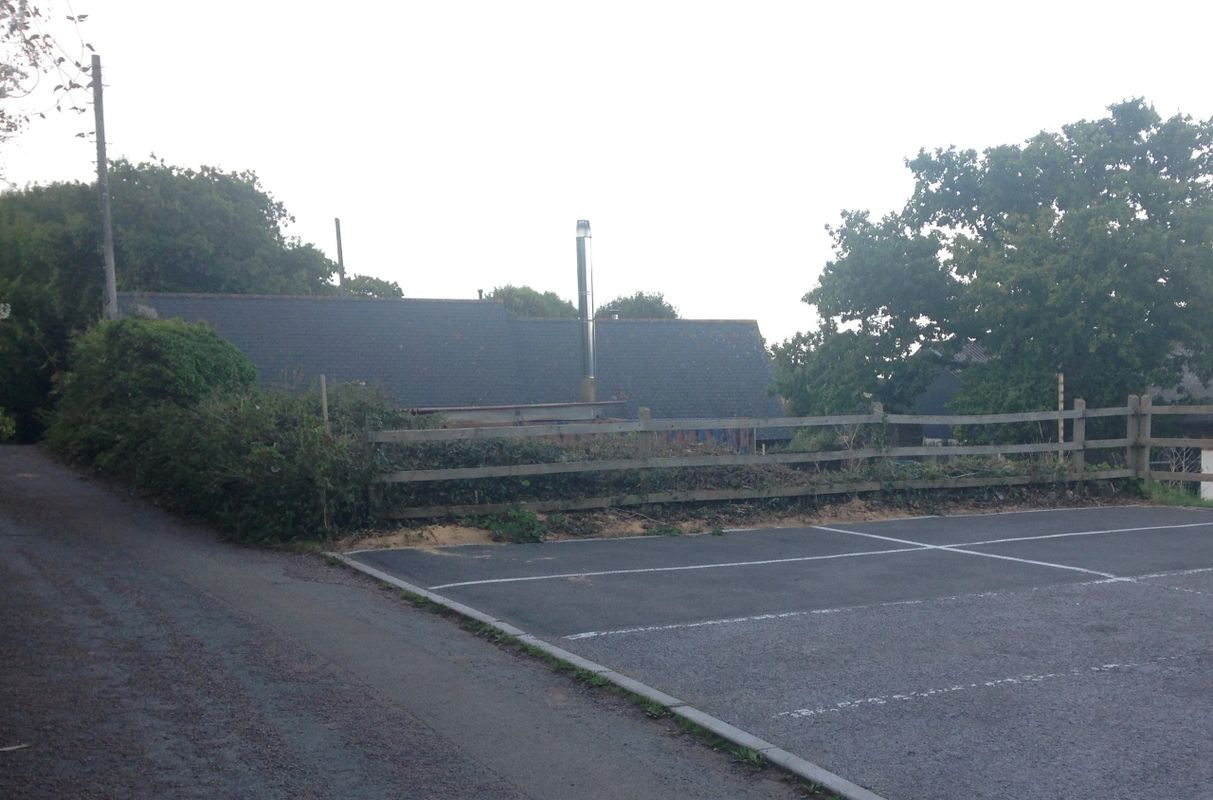 View across the Village Hall car park to the future site