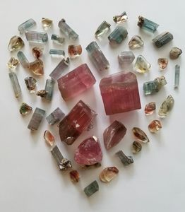 Several gemstones including Oregon sunstone,  Tourmaline, and Aquamarine from the U.S.A