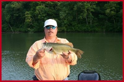 Dubby Carr, Owner of Dubby's Fishing and Hunting, shows off a great catch on Lake Anna, Virginia.