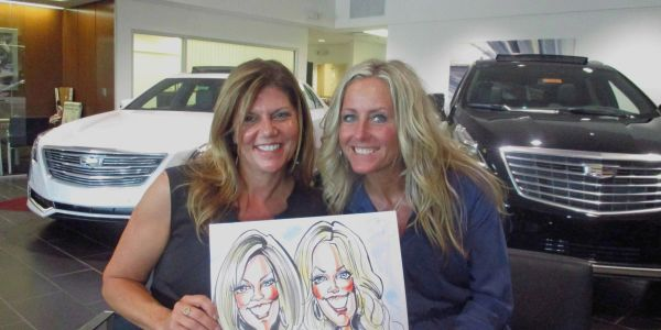 Caricatures by Walt Griggs at Suburban Cadillac-Ann Arbor event.