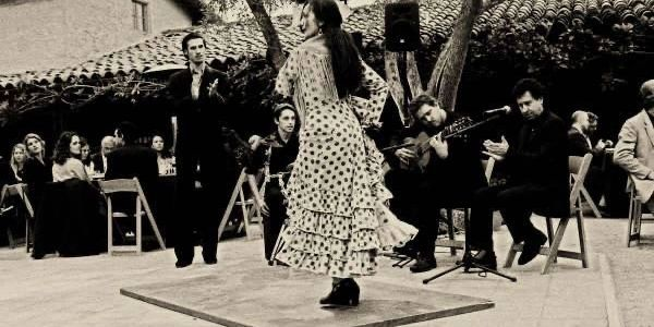 Berto Boyd performs with Flamenco dancers at a private event