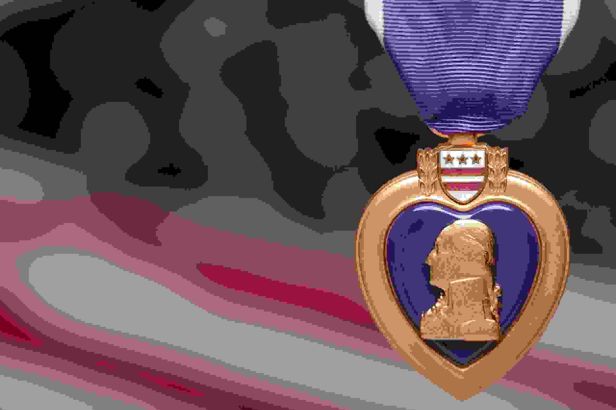 Purple Heart metal, American flag in background