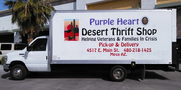 White box truck featuring company information and the words pick-up and delivery