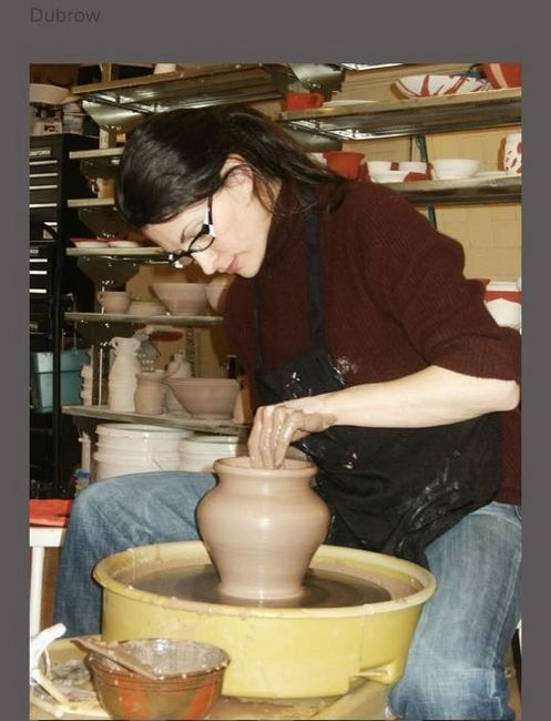 Potter and studio owner Nicole Dubrow demonstrates turning a vase during a field interview.