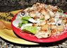 Caesar Salad topped with grilled chicken