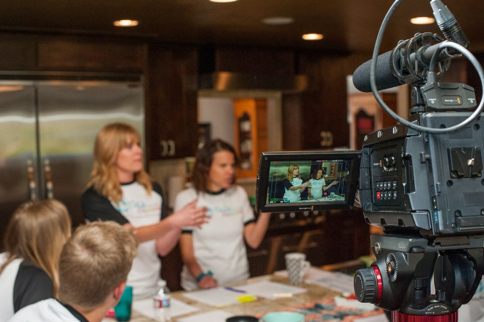 Co-Founders, Audrey Walters and Jenny Gilbert, talking to instructors, while being filmed.