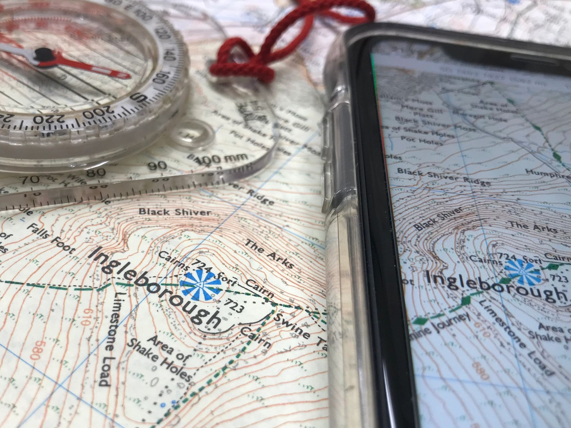 Map and compass with mapping and navigation software on a smart phone