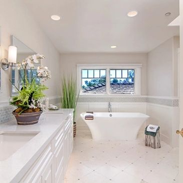 This Is a Beautiful Master Bathroom, It Has A Custom Cabinet and Quartz Countertop, Limestone Floor In A Diamond Pattern, Stand Alone Tub.