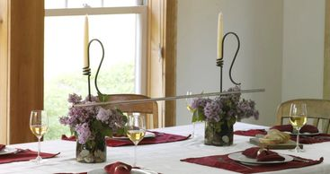 Spring Tabletop centerpiece. Wine Chime Toasting Bar in glass vase with river rocks and Lilacs