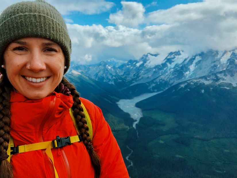 Personal trainer standing on top of a mountain in British Columbia