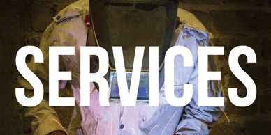 "Welder working with text overlaid that says ""services"""