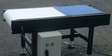 small show case conveyor showing a variety of belt surfaces