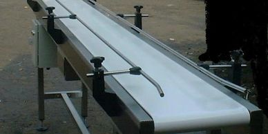 side guide alignment food grade conveyor ensuring smooth production transfer,in stainless steel