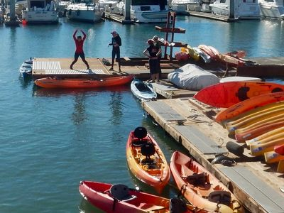 Kayaks are ready for customers to be on the SF bay.