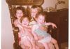 Dino, the twins and I. How many's kids can you fit on a rocking chair?