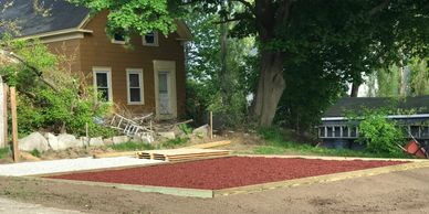 Swing set box, made out of a pressure treated perimeter with rubberized mulch Landscape Services