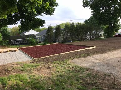 Shed pad installed to the left of the swing set box Excavation: utility pads, Atkinson, NH