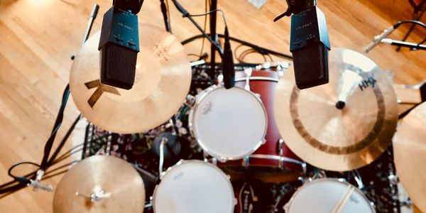 Online drum session with AKG C414 B ULS, Sennheiser MD421's, and Gretsch drums, session drummer