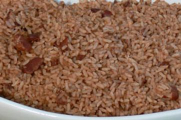 Rice & peas cooked till fluffy with seasoning and red beans cooked by Golden Krust Port Charlotte.