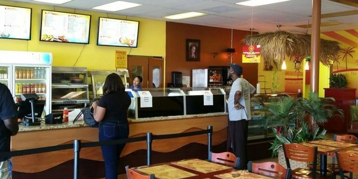 Inside Golden Krust Port Charlotte. Serving customers chicken, sandwich, fish, seafood.