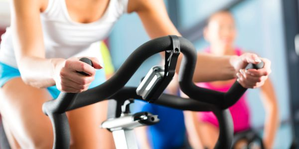 Woman riding exercise bike in the fitness center